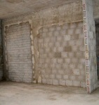 Plastering over the bricks