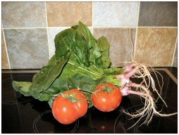 Yes this IS spinach with a couple of BIG tomatoes!